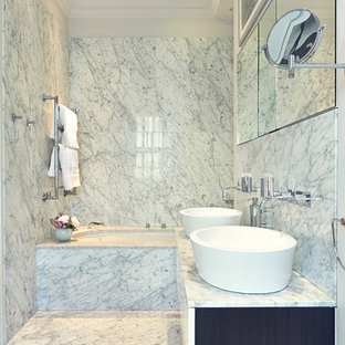 Trendy marble tile bathroom photo in London with a vessel sink