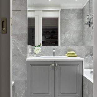 На фото: главные ванные комнаты среднего размера в стиле современная классика с серой плиткой, керамической плиткой, столешницей из плитки, фасадами с выступающей филенкой, серыми фасадами, ванной в нише, душем над ванной, накладной раковиной, серым полом, серыми стенами, мраморным полом и открытым душем