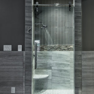Large trendy master gray tile and glass tile porcelain tile, gray floor and double-sink bathroom photo in Other with raised-panel cabinets, white cabinets, an undermount tub, a one-piece toilet, gray walls, an undermount sink, quartzite countertops, gray countertops and a floating vanity