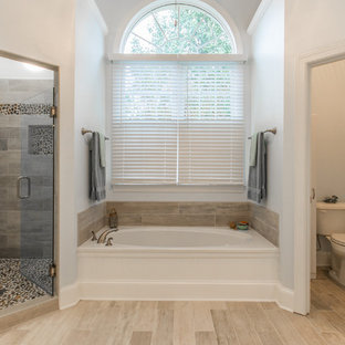 Example of a classic pebble tile bathroom design in Other with a two-piece toilet