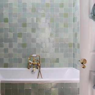 Drop-in bathtub - eclectic green tile and terra-cotta tile slate floor drop-in bathtub idea in London with a drop-in sink, furniture-like cabinets, distressed cabinets, wood countertops, a one-piece toilet and white walls
