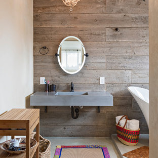 Example of a southwest master bathroom design in Denver with an integrated sink