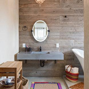 Esempio di una stanza da bagno padronale stile americano di medie dimensioni con pareti marroni, lavabo sottopiano, top in cemento, pavimento grigio e top grigio