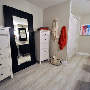 Example of a mid-sized transitional white tile and ceramic tile bathroom design in Calgary with an integrated sink, flat-panel cabinets, dark wood cabinets, solid surface countertops, a two-piece toilet and gray walls