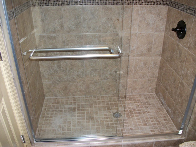 Traditional Bathroom by Green Line Construction Corp