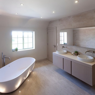 Large contemporary ensuite bathroom in West Midlands with flat-panel cabinets, light wood cabinets, a freestanding bath, a walk-in shower, beige tiles, ceramic tiles, white walls, ceramic flooring, quartz worktops and a built-in sink.
