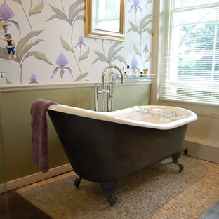 Ornate pebble tile pebble tile floor claw-foot bathtub photo in London with multicolored walls