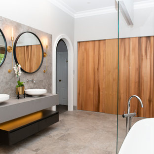 Inspiration for a large contemporary master wet room bathroom in Melbourne with open cabinets, black cabinets, a freestanding tub, a bidet, gray tile, ceramic tile, grey walls, ceramic floors, a console sink, engineered quartz benchtops, grey floor, an open shower, grey benchtops, a double vanity and a floating vanity.