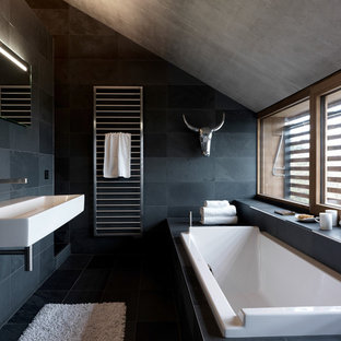 Inspiration for a contemporary bathroom in Orange County with a wall-mounted sink and slate tiles.