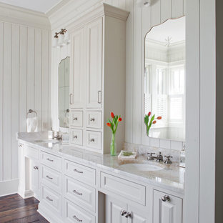 Bathroom - farmhouse dark wood floor and brown floor bathroom idea in Atlanta with raised-panel cabinets, white cabinets, white walls and an undermount sink