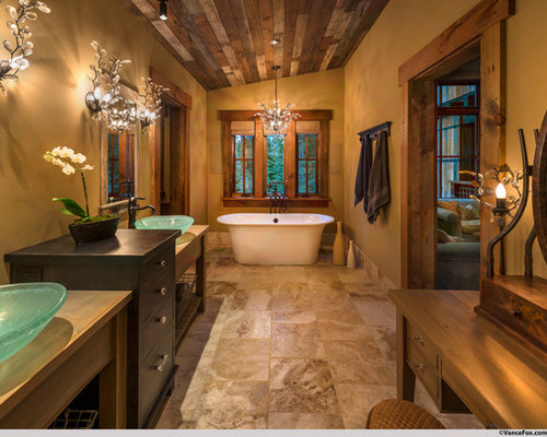 Example Of A Large Mountain Style Master Ceramic Floor And Brown Freestanding Bathtub Design In