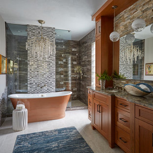 Inspiration for a transitional master multicolored tile gray floor bathroom remodel in Houston with shaker cabinets, medium tone wood cabinets, gray walls, an undermount sink, a hinged shower door and multicolored countertops