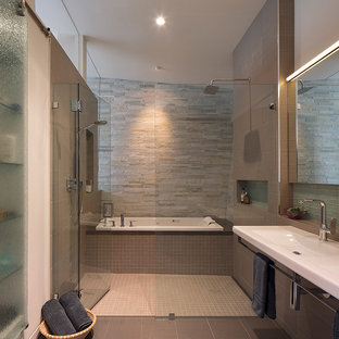 Example of a trendy beige tile bathroom design in San Francisco with a trough sink