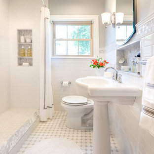Bathroom - small traditional 3/4 white tile and mosaic tile mosaic tile floor and white floor bathroom idea in Houston with a pedestal sink, marble countertops, a one-piece toilet, gray walls, glass-front cabinets and white cabinets
