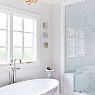 Freestanding bathtub - mid-sized contemporary master white tile and subway tile marble floor and white floor freestanding bathtub idea in Nashville with gray walls