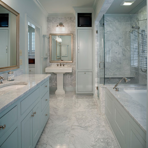 Example Of A Classic White Tile Corner Shower Design In New Orleans With A  Pedestal Sink