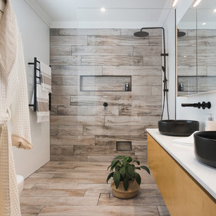 Inspiration for a contemporary 3/4 bathroom in Brisbane with flat-panel cabinets, light wood cabinets, an alcove shower, white walls, a vessel sink and beige floor.