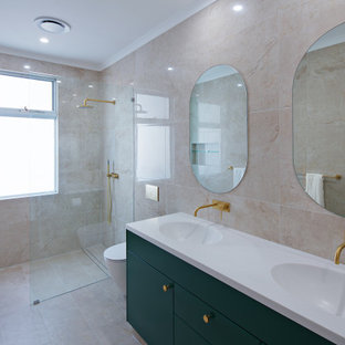 Design ideas for a contemporary bathroom in Sydney with flat-panel cabinets, green cabinets, a curbless shower, beige tile, an integrated sink, beige floor, an open shower, white benchtops, a double vanity and a floating vanity.