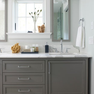 Inspiration for a beach style bathroom remodel in Boston with marble countertops, gray cabinets, shaker cabinets, gray walls and a drop-in sink