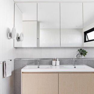This is an example of a mid-sized contemporary master bathroom in Sydney with light wood cabinets, white tile, gray tile, ceramic tile, white walls, porcelain floors, grey floor, a double vanity, a floating vanity, flat-panel cabinets, an integrated sink and white benchtops.