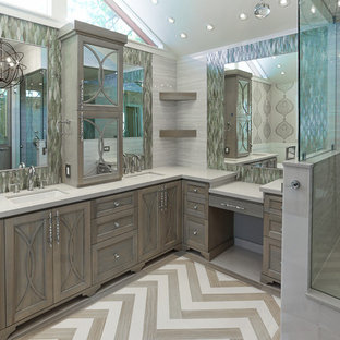 Freestanding bathtub - mid-sized transitional master gray tile and porcelain tile porcelain floor freestanding bathtub idea in Houston with an undermount sink, furniture-like cabinets, gray cabinets, quartzite countertops, a two-piece toilet and gray walls