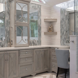 Inspiration for a mid-sized transitional master gray tile and porcelain tile porcelain tile bathroom remodel in Houston with an undermount sink, furniture-like cabinets, gray cabinets, quartzite countertops, a two-piece toilet and gray walls