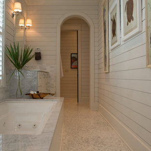 Photo of a coastal bathroom in Miami with a submerged bath and white tiles.