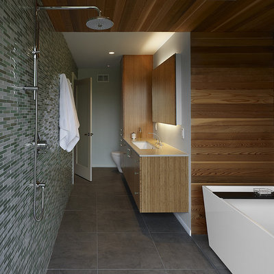 Mid-sized minimalist master mosaic tile gray floor bathroom photo in San Francisco with a one-piece toilet, gray walls, an undermount sink, flat-panel cabinets, light wood cabinets, quartz countertops and white countertops