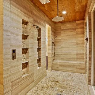 Bathroom - mediterranean stone tile pebble tile floor bathroom idea in New Orleans with a niche