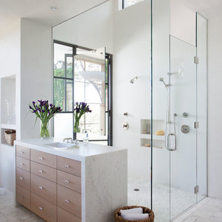 Large tuscan master white tile marble floor walk-in shower photo in Austin with flat-panel cabinets, medium tone wood cabinets and white walls