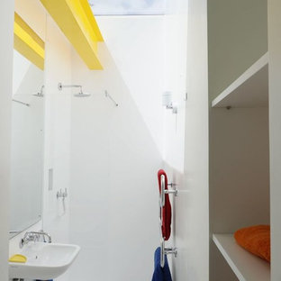 Design ideas for a medium sized modern shower room bathroom in London with open cabinets, white cabinets, white walls, white floors, an open shower, white tiles and a wall-mounted sink.