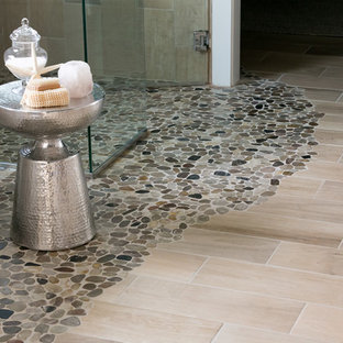 Example of a mid-sized arts and crafts master beige tile and porcelain tile porcelain floor and beige floor bathroom design in Other with flat-panel cabinets, white cabinets, gray walls, an undermount sink, granite countertops and a hinged shower door