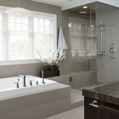 Inspiration for a mid-sized contemporary gray tile and porcelain tile slate floor drop-in bathtub remodel in Toronto with dark wood cabinets, marble countertops and gray walls