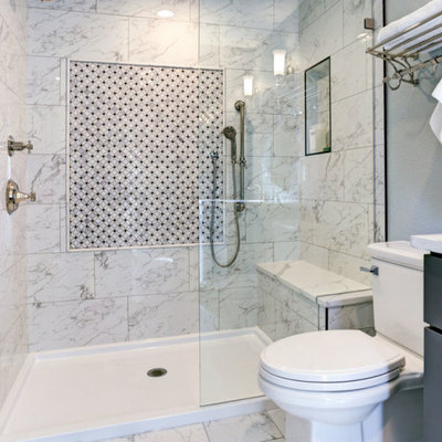 Example of a small trendy 3/4 white tile and marble tile marble floor and white floor alcove shower design in Other with shaker cabinets, gray cabinets, a two-piece toilet, white walls, an undermount sink, quartzite countertops, a hinged shower door and white countertops