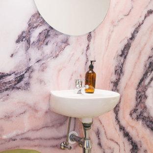 Bild på ett litet shabby chic-inspirerat badrum, med rosa kakel, rosa väggar och ett väggmonterat handfat