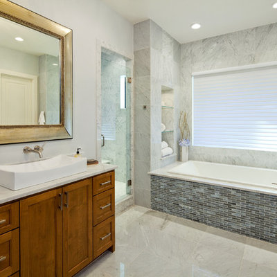 Example of a trendy mosaic tile bathroom design in Austin with a vessel sink
