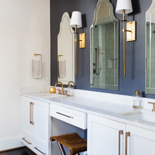 Transitional bathroom photo in Birmingham with shaker cabinets, white cabinets, blue walls, an undermount sink and white countertops