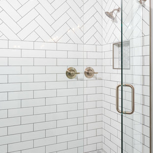 Example of a mid-sized transitional master white tile and subway tile porcelain tile and gray floor alcove shower design in Other with shaker cabinets, white cabinets, a two-piece toilet, gray walls, an undermount sink, quartz countertops, a hinged shower door and white countertops