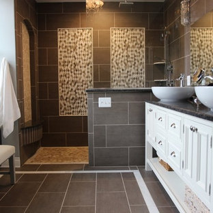 Inspiration for a mid-sized timeless master gray tile and cement tile ceramic floor and gray floor doorless shower remodel in Detroit with furniture-like cabinets, white cabinets, a wall-mount toilet, blue walls, a vessel sink and granite countertops
