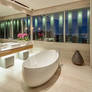 Inspiration for a large modern master vinyl floor bathroom remodel in Los Angeles with flat-panel cabinets, medium tone wood cabinets, beige walls, a vessel sink and quartz countertops