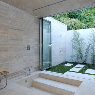 Example of a minimalist beige tile bathroom design in Los Angeles