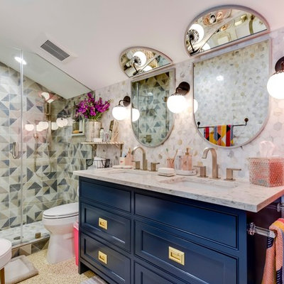 Alcove shower - eclectic kids' multicolored tile alcove shower idea in Austin with furniture-like cabinets, blue cabinets, multicolored walls, an undermount sink, a hinged shower door and multicolored countertops