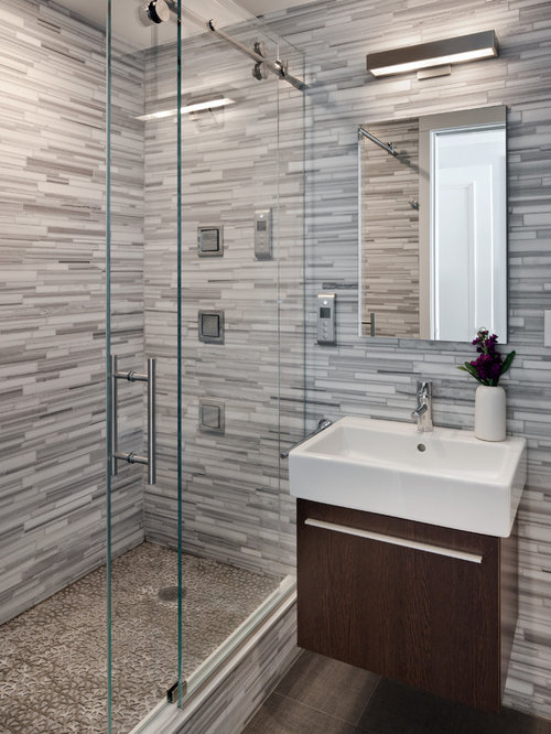 Example Of A Trendy Master Gray Tile And Matchstick Ceramic Floor Alcove Shower Design In
