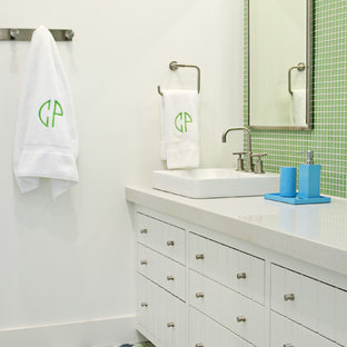 Inspiration for a contemporary green tile bathroom remodel in Austin with white cabinets