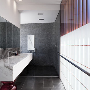 Example of a trendy black tile slate floor bathroom design in Sydney with a wall-mount sink, marble countertops and white walls