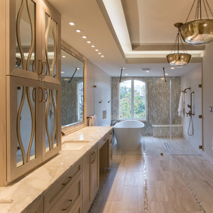 Large transitional master gray tile and porcelain tile porcelain tile and gray floor bathroom photo in Houston with an undermount sink, furniture-like cabinets, white cabinets, marble countertops, a two-piece toilet, gray walls, a hinged shower door and gray countertops