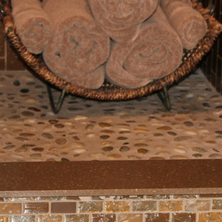 River rock shower floor with crackled glass tiles for outside curb