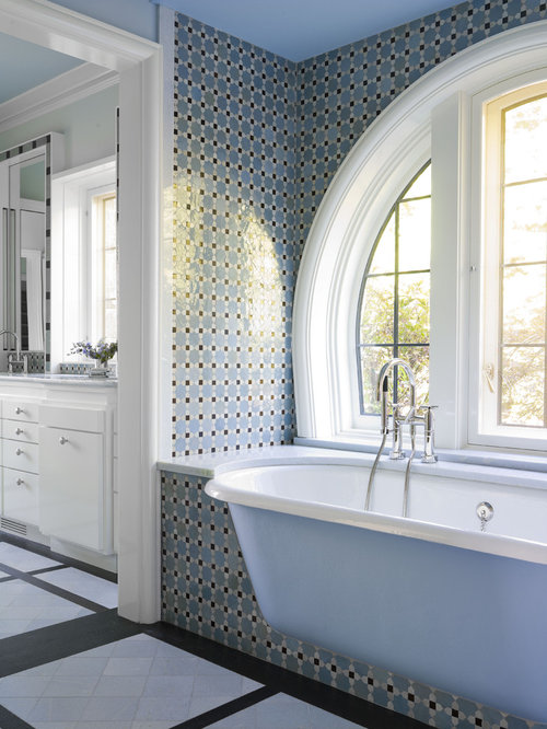 elegant bathroom photo in new york with mosaic tile