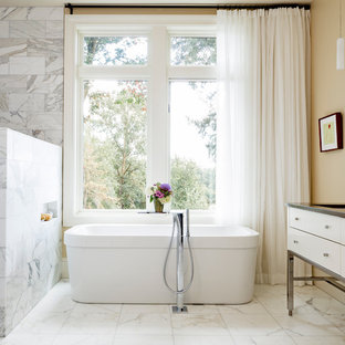 Large trendy master white tile and stone tile marble floor and gray floor bathroom photo in Portland with flat-panel cabinets, white cabinets, beige walls, an undermount sink and engineered quartz countertops