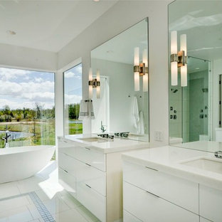 Inspiration for a contemporary white tile freestanding bathtub remodel in Boise with flat-panel cabinets, white cabinets and white countertops